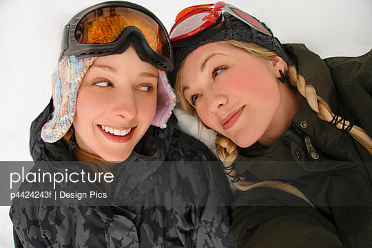 Two girls in winter wear with ski glasses