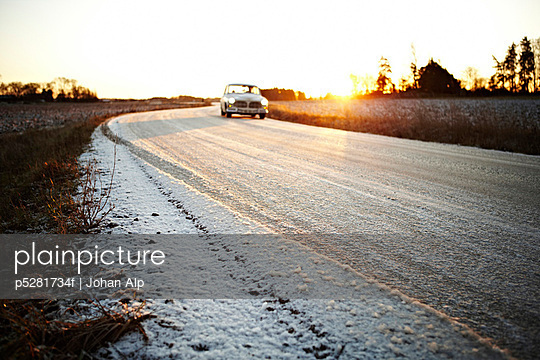 A wintry road at sunset Sweden