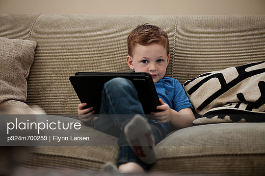 Boy with digital tablet