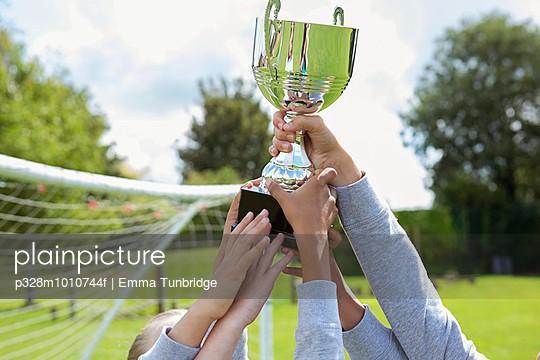 School soccer team holding trophy