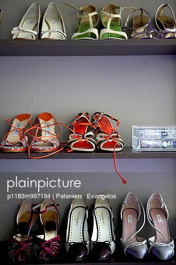 Eight pairs of ladies\' shoes in grey shoe rack