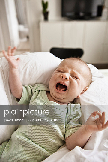 Infant crying in bed