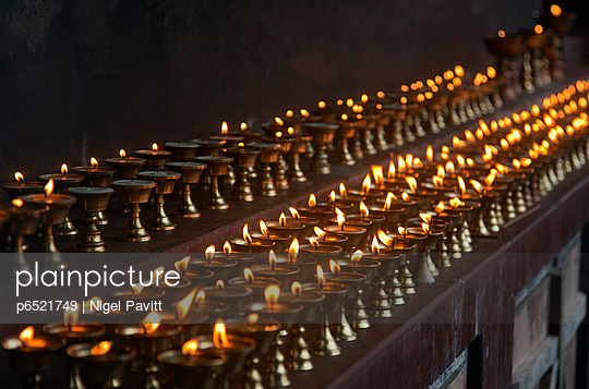 A long line of butter lamps burning at the Changangkha Temple, a fine 15th century temple, on the outskirts of Thimphu
