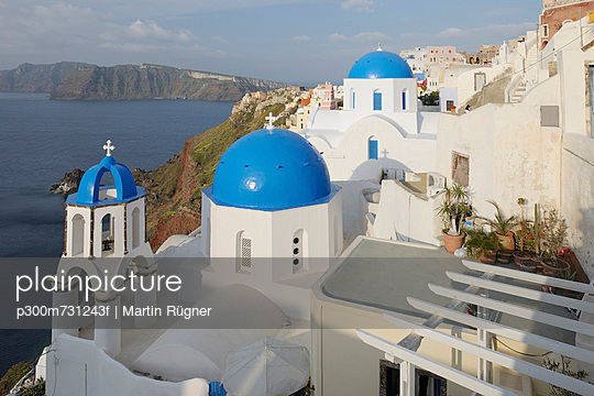 View of classical whitewashed church at Oia village