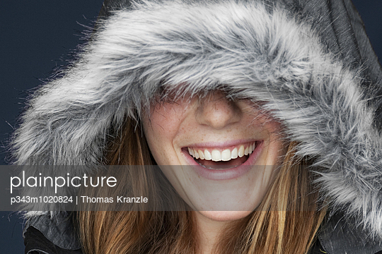 Happy girl in winter cloths.
