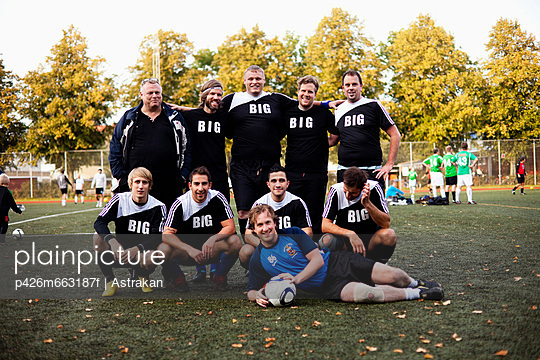 Team portrait of soccer players in playing field