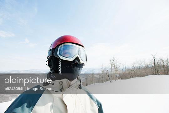 Woman wearing ski goggles, portrait