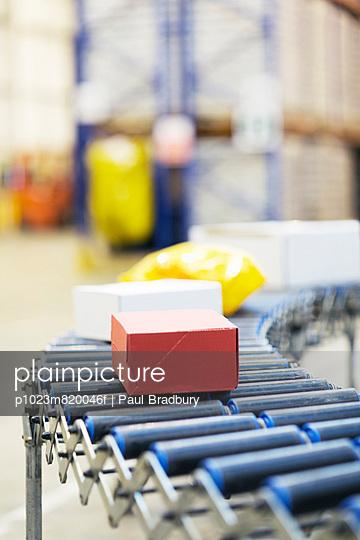 Packages on conveyor belt in warehouse