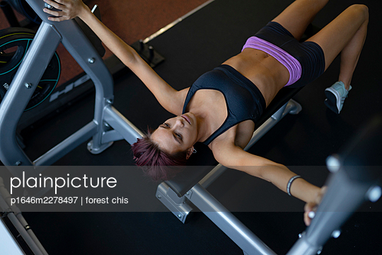Young woman doing fitness training - p1646m2278497 by Slava Chistyakov