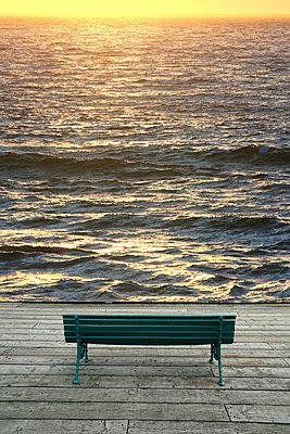 Bench on boardwalk overlooking Ocean. - p1328m1165895 by Pierre Desrosiers