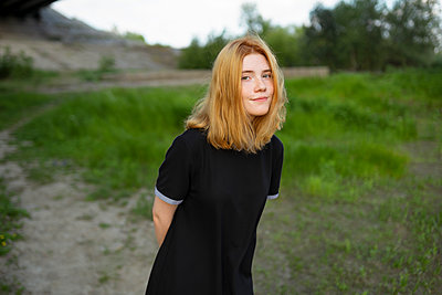 Young woman takes a walk outdoors - p1646m2229935 by Slava Chistyakov