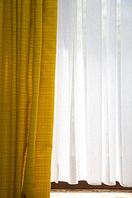 Yellow curtain and back light - p2380274 by Anja Bäcker