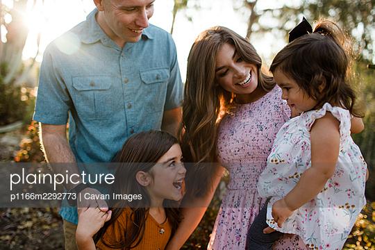 Family Standing in Desert Garden in San Diego - p1166m2292773 by Cavan Images