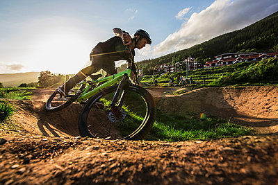 Biker rides a pump track in Are, Sweden. - p343m1090331 by Elias Kunosson
