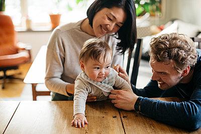 Parents with baby - p312m2139468 by Amanda Falkman