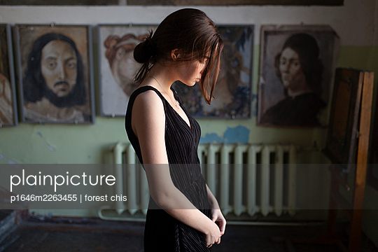 Young woman in black dress in the background paintings - p1646m2263455 by Slava Chistyakov