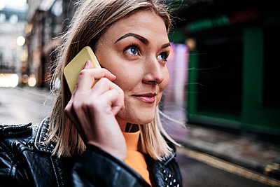 Slovak young woman talking with cellphone in city. - p1166m2227653 by Cavan Images