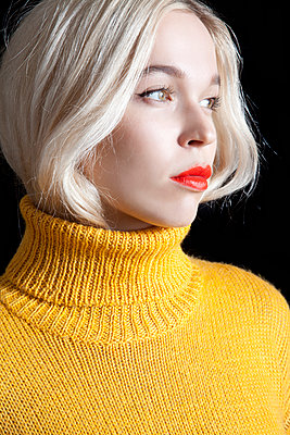 Blond Woman in Yellow Rollneck  - p1248m1516245 by miguel sobreira