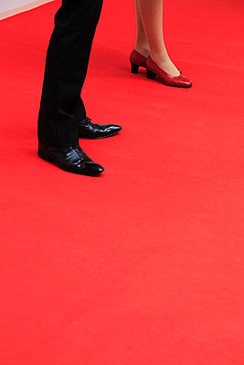 Legs of female and male host on the red carpet - p2651413 by Oote Boe