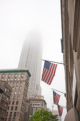 Broadway and Empire State Building shrouded in mist, Manhattan, New York City, New York, United States of America, North America - p871m1073180f by Fraser Hall