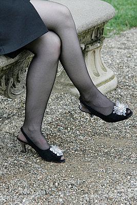 Woman in black stockings - p4760319 by Ilona Wellmann