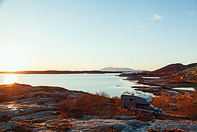 Sunset over fjord scenery - p1168m1138034 by Thomas Günther