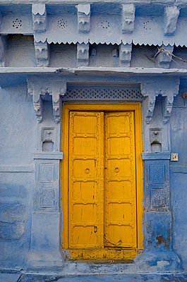 Old Yellow Door in Blue Wall - p1562m2147984 by chinch gryniewicz