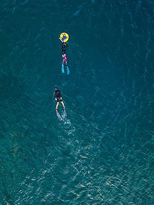 Freedivers with buoy in ocean - p300m2080787 by Konstantin Trubavin