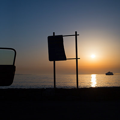 Sunset by the sea  - p1542m2142292 by Roger Grasas