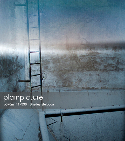 Blurred ladder inside grain silo. France - p378m1117336 by Shelley Belboda