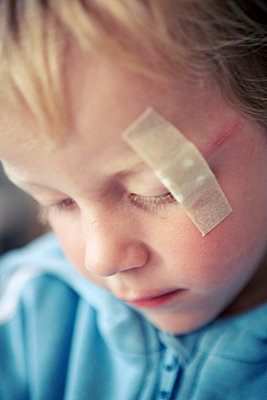 Boy with plaster on head - p5282785 by Dan Lepp