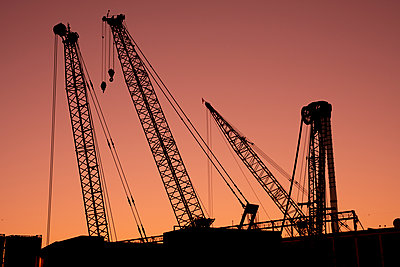Construction cranes at sunset - p401m2196326 by Frank Baquet