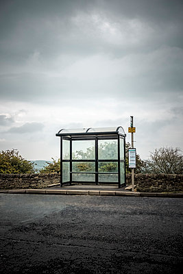 Modern bus shelter at the side of a road - p1302m1510403 by Richard Nixon