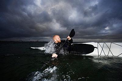 Man in kayak rotating - p42913681f by Soren Hald