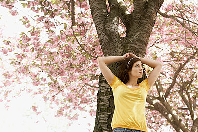 Woman under a cherry tree - p7350055 by Thomas Prinz