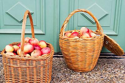 Wicker baskets with apples - p312m1121613f by Rebecca Wallin