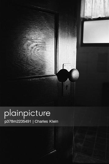 Doorkb in shadows - p378m2235491 by Charles Klein