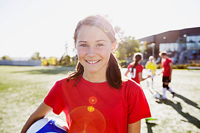 Teenage soccer player holding soccer ball. - p1192m1219215 by Hero Images