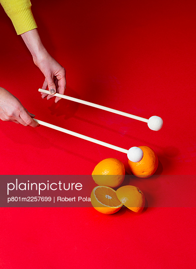 Hand, Drumsticks and orange - p801m2257699 by Robert Pola