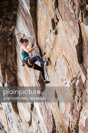 Teenage girl rock climbing - p1427m2077569 by Don Mason