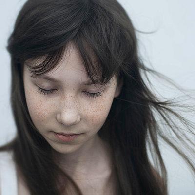 Wind blowing hair of Caucasian girl - p555m1444279 by Vladimir Serov