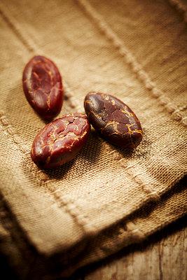 Three cocoa beans - p968m658871 by Roberto Pastrovicchio