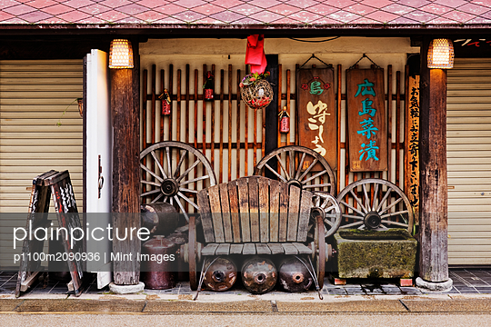 Worn Bench on an Asian Porch - p1100m2090936 by Mint Images