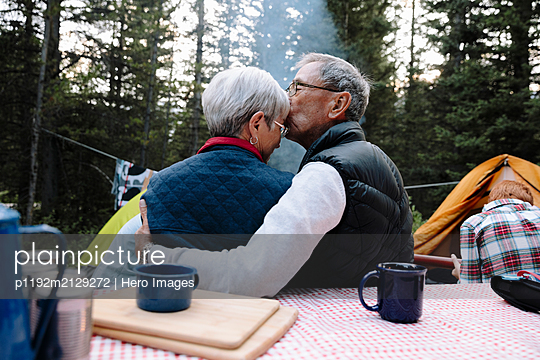 Affectionate senior couple at campsite - p1192m2129272 by Hero Images