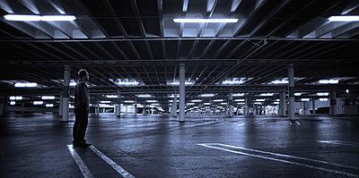 Man in a parking garage - p911m945292 by matthieu grospiron