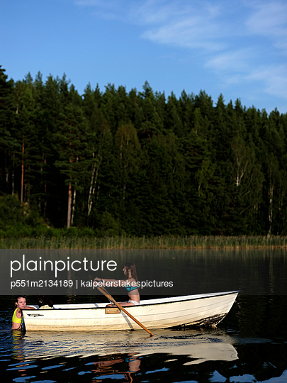 Rowing a boat in the lake - p551m2134189 by kaipeterstakespictures