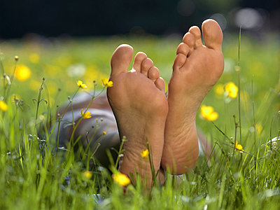 The soles of a person's bare feet, close up - p3017787f by Paul Hudson