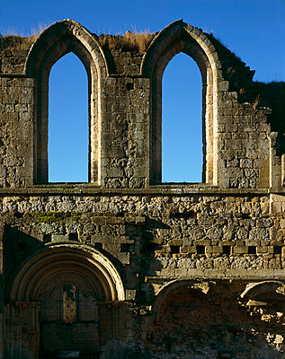 Rievaulx Abbey. Detail of Early English windows Showing romanesque arcading beneath . - p8551785 by Paul Highnam