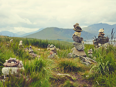 Stacked pebbles, hiking trail, Scottish Highlands - p913m2172591 by LPF
