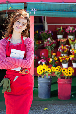 Florist holding notebook in shop - p924m807206f by InStock